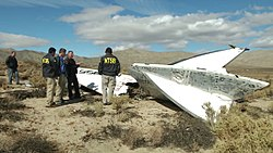 NTSB Go-Team inspects a tail section of VSS Enterprise.jpg