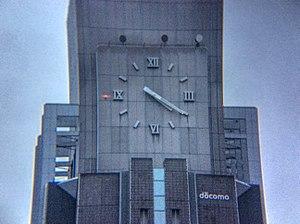 NTT Docomo Yoyogi Building - Close-up of clock face detail