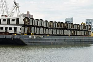 New York City Subway rolling stock - Retired subway cars being transported to the ocean, where they will be dropped into the water to create an artificial reef