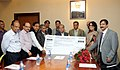 Narendra Singh Tomar receiving the dividend cheque from the CMD, NALCO, Shri Ansuman Das, in New Delhi on November 13, 2014. The Secretary, Ministry of Mines, Dr. Anup K Pujari is also seen.jpg