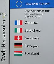 Sign denoting twin towns of Neckarsulm, Germany