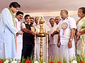 Nitin Gadkari lighting the lamp at the foundation stone laying ceremony for the four laning of Thiruvananthapuram bypass, at Kazhakkoottam, in Thiruvananthapuram. The Chief Minister of Kerala, Shri Oommen Chandy.jpg