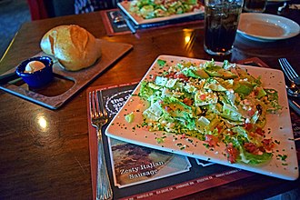 The Old Spaghetti Factory - A BLT salad with creamy pesto dressing with bread from The Old Spaghetti Factory