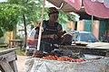 Old woman selling river fish and banga.jpg