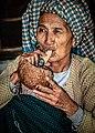 Old woman smoking a cigar.jpg