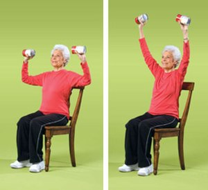 Adult development - An older adult performing a recommended exercise for aging individuals.