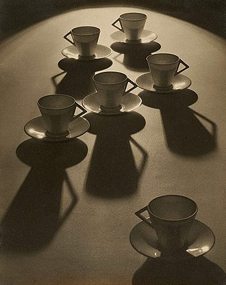 F. W. Woolworth Company - Tea cup ballet, a 1935 photograph by Olive Cotton with some inexpensive cups and saucers from Woolworths