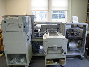 Print on demand - An on-demand book printer at the Internet Archive headquarters in San Francisco, California. Two large printers print the pages (left) and the cover (right) and feed them into the rest of the machine for collating and binding. Depending on the number of pages, printing may take 5 to 20 minutes.