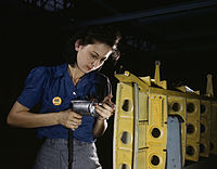 Operating a hand drill this woman worker is shown working on the horizontal stabilizer.jpg