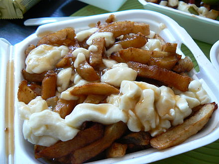 Poutine, a Canadian dish of fried potatoes, cheese curds, and gravy OriginalPoutineLaBanquise.jpg