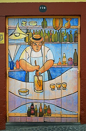 """Preparation of """"Poncha"""" - the traditional beverage of Madeira. Image on the door in Funchal."""