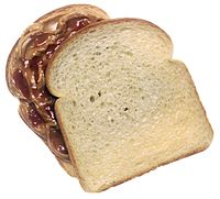 Peanut butter and jelly sandwich, top slice of bread turned clockwise to show the peanut butter and jelly filling.jpg