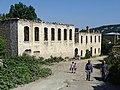 Pedestrians with War-Ruined Facade - Shushi - Nagorno-Karabakh (18961208868).jpg