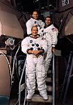 Pete Conrad (front), Dick Gordon (middle), and Al Bean (rear) pose in front of a simulator.jpg
