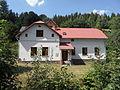 Petrovice (okres Bruntál) E. Dům za potokem.jpg