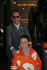 Manning poses with a fan in 2006