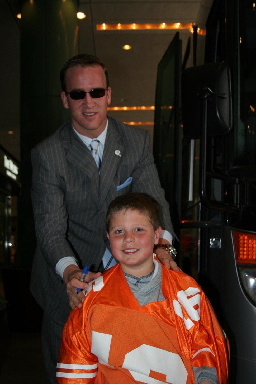 Peyton Manning in suit