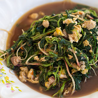 Amaranthus spinosus - Phat phak khom is a Thai stir-fried dish of the young shoots of the Amaranthus spinosus. This version is stir-fried with egg and minced pork.