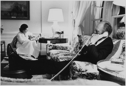 U.S. President Gerald Ford on the phone Photograph of First Lady Betty Ford Reading a Newspaper, while President Ford Talks on the Telephone, in the Second... - NARA - 186793.tif