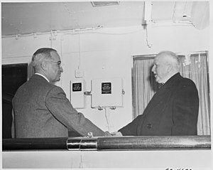 Photograph of President Truman welcoming the U.S. Ambassador to Great Britain, Walter Gifford, aboard the... - NARA - 199021.jpg