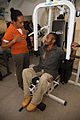 Physiotherapist Saimonah Mokupe assisting clients using AusAID donated equipment (10713145136).jpg