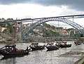 Portugal (Porto) Rabelo boats and Dom Louis I Bridge, double deck metal arch bridge (35321565724).jpg