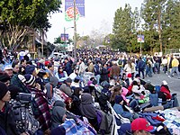 Spectators gather before the 2004 Rose Parade.