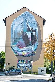 2017年、ドイツのマンハイムにあるネバークルーによって実現された壁画「プロパゲーティングマシン」。