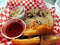 Pupusa and yucca frita from Guanaco food truck (11594529115).jpg