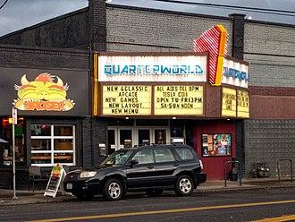 Alhambra Theatre (Portland, Oregon) - Quarterworld at Alhambra Theater Portland Oregon. Baoser, also owned by Quarterworld, at left.