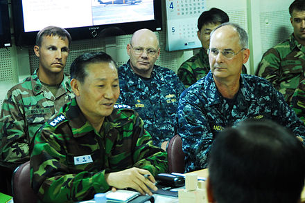 Vice Admiral Kim Jung Du, commander for the Republic of Korea Navy salvage efforts, and Rear Adm. Richard Landolt, on scene commander of U.S. support to South Korean salvage efforts, discuss salvage operations aboard the ROKS Dokdo ROKS Cheonan salvage meeting.jpg