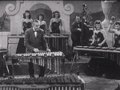 Reg Kehoe and his Marimba Queens.png