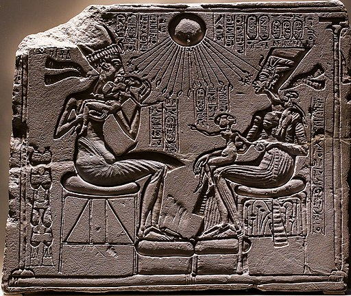 Akhenaton and Nefertiti with three of their daughters