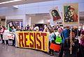 Resist sign at SFO -noban Protest -Jan 29, 2016 (32605180615).jpg
