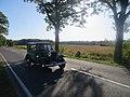Reuden, Anhaltischer Rundsockelstein an der B 246 (3) mit Opel-Automobil.jpg