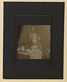 Reverend William Booth, General of the Salvation Army sitting at a table and apparently partaking of refreshment (HS85-10-22542).jpg