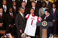 Rick Pitino presents Obama with custom Louisville jersey.jpg