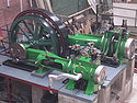 Robey cross-compound steam engine, three-quarter view from above, Bolton museum.jpg