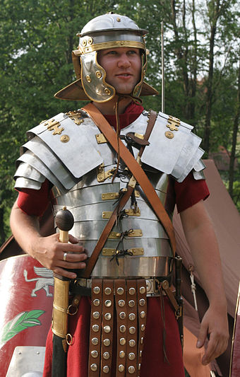 Modern replica of lorica segmentata type armor, used in conjunction with the popular chainmail after the 1st century AD Roman soldier in lorica segmentata 1-cropped.jpg
