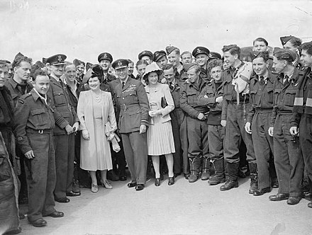 George VI, Queen Elizabeth, and Princess Elizabeth standing with a group of RAF personnel Royal Air Force Bomber Command, 1942-1945. CH20901.jpg