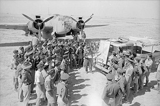 Peter Le Cheminant - Wing Commander Le Cheminant briefs aircrews for a bombing raid on La Fauconnerie South, Tunisia (scene reconstructed after the event).