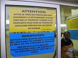 Aircraft hijacking - Warning posters in a Central African airport, in French and English. June 2012