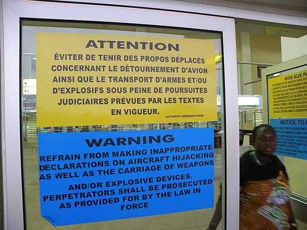 Warning posters in a Central African airport, June 2012 Securite Aerienne Afrique.JPG