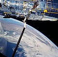 STS-31 Hubble Space Telescope (HST) solar array (SA) deploy aboard Discovery.jpg