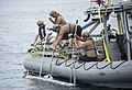 Sailors attach tow lines to a Mark 18 Mod. (36276500982).jpg