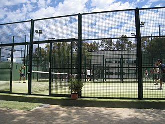 Padel (sport) - Padel players on outdoor padel courts