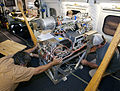 Scientists and technicians ready an instrument rack for mounting in NASA's DC-8 flying laboratory.jpg