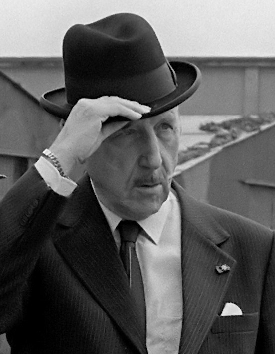 Secretary General of NATO Luns tips his hat as a troop review 1983