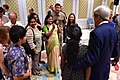 Secretary Kerry poses for photos with family of locally hired staff at US Embassy in New Delhi.jpg
