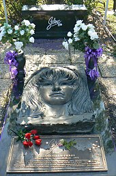 Elaborate grave marker with flowers